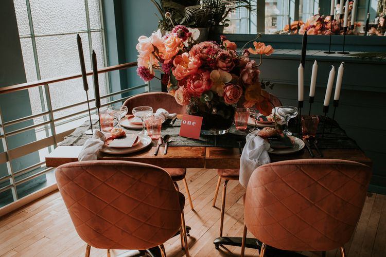 Living Coral Retro Table Decor with Floral Centrepiece , Velvet Chairs,  and Candle Sticks
