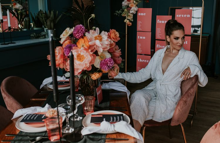 Stylish Bride in Sequin Jump-suit Sitting at Retro Tablescape
