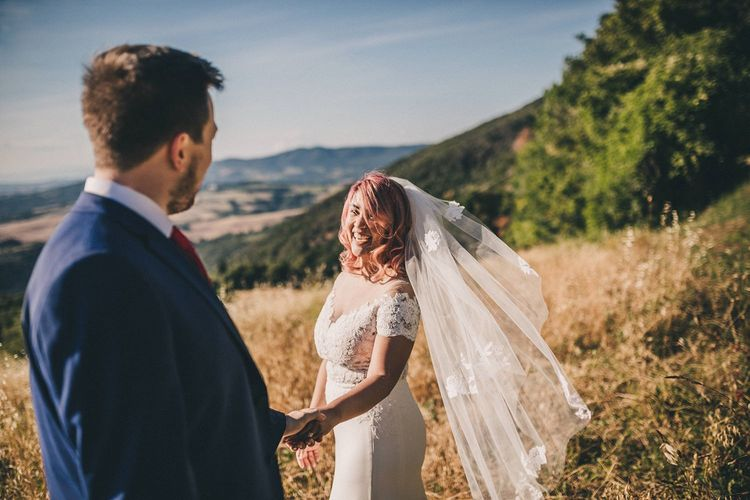 Bride in lace trim veil and groom at Italian wedding