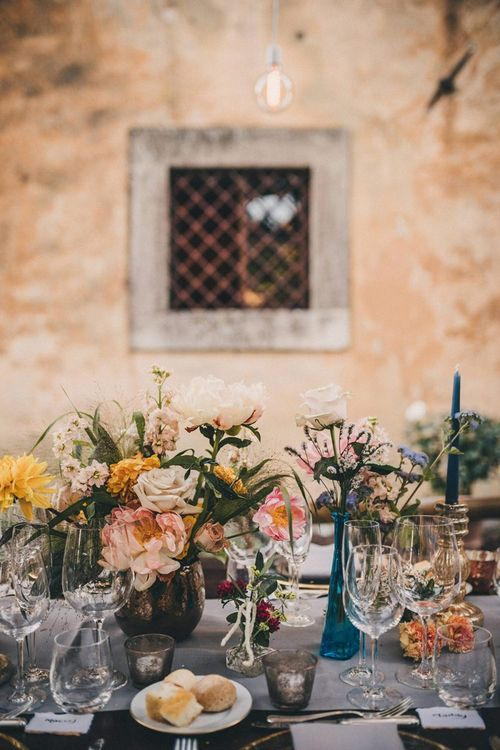 Wedding table decor with pink and yellow flowers at Villa di Ulignano
