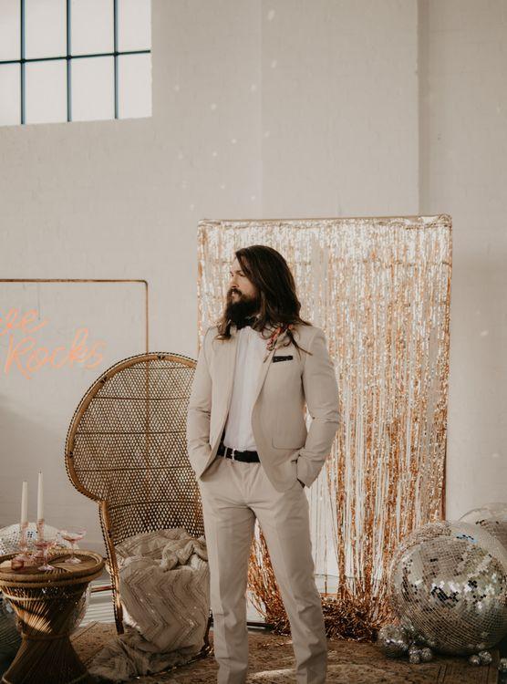 Contemporary groom in beige wedding suit