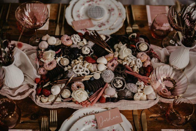 Sweet treat serving platter with macaroons, meringue kisses and mini doughnuts