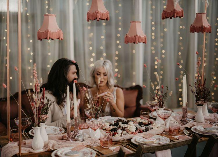 Blush pink vintage tassel installation and table decor