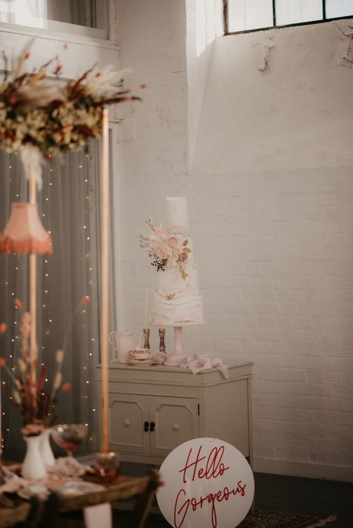 White and pink tall wedding caked with dried flower detail