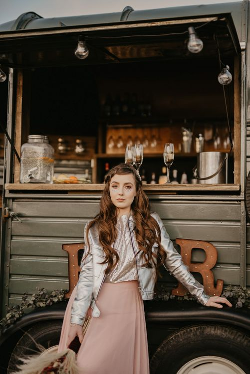 Bridesmaid in pink skirt, silver top and leather jacket