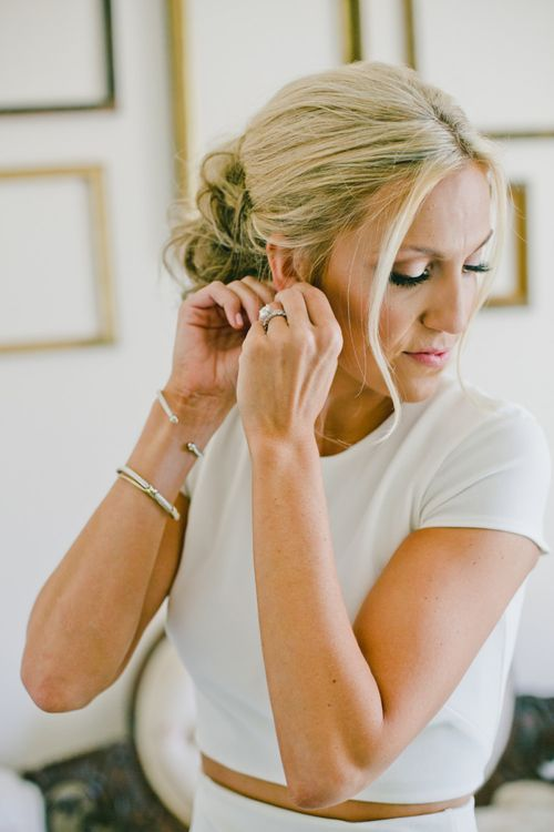 Wedding Morning Bridal Preparations with Bride Putting on Her Earrings