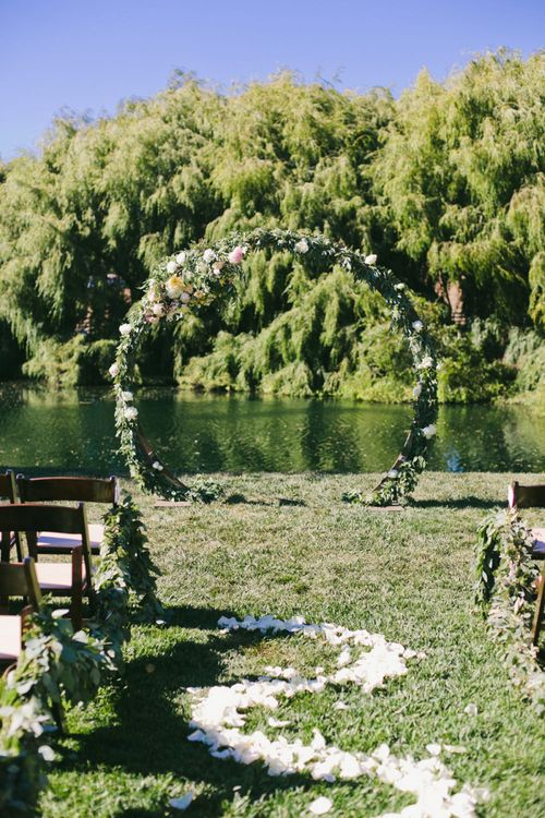 Outdoor Wedding Ceremony with Floral Moon Gate Altar