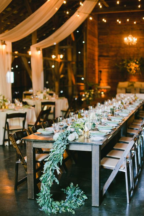 Ranch Wedding Reception with Drape Decor and Greenery Table Runner