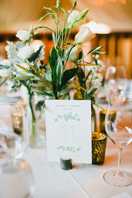 Green and White Table Number Sign and Floral Centrepiece