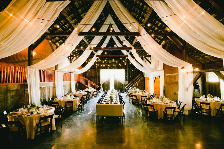 Ranch Wedding Reception  with Drapes and Fairy lights Decor