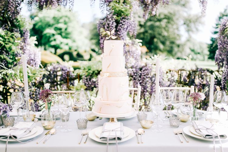 Elegant Four Tier Wedding Cake with Gold Glitter Detail