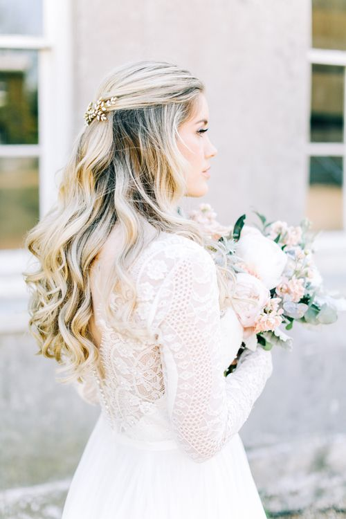 Bride in Lace Long Sleeve Wedding Dress with Half Up Half Down Wavy Hair
