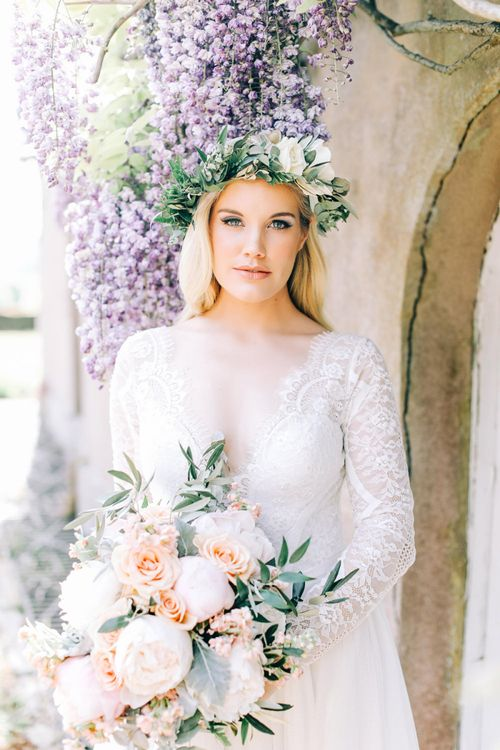 Bride in Flower Crown Holding Peach and White Wedding Bouquet