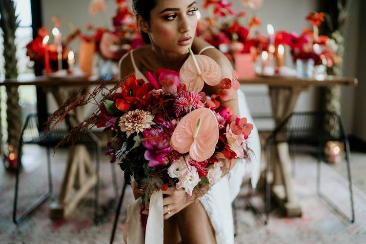 Modern Bride Holding a Pink and Red Wedding Bouquet with Anthurium Flower Stems