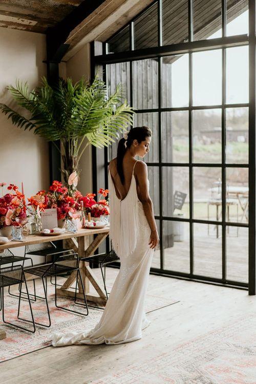 Bride in Low Back Wedding Dress with Fringe Detail