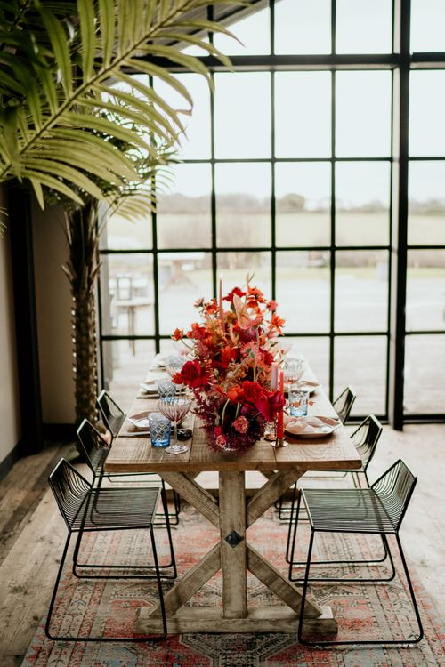 Modern Pink and Red Table Flowers in Front of a Floor to Ceiling Window