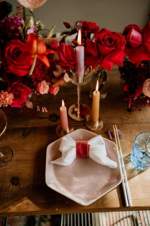 Place Setting with Pink Plate,  Bow Napkin, Taper Candles and Floral Centrepiece