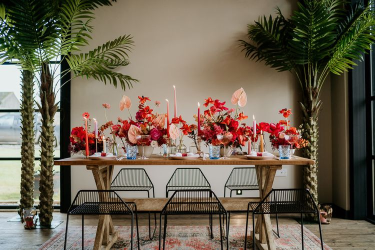 Red and Pink Wedding Flowers with Anthurium Flower Stems, Taper Candles and Coloured Glasses