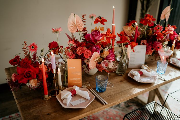 Modern Tablescape with Pink and Red Floral Centrepieces, Taper Candles, and On the Day Stationery