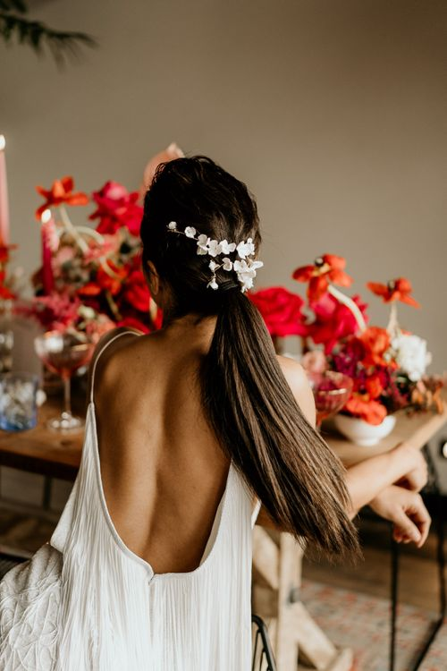 Low Back Fringe Wedding Dress and Sleek Bridesmaid Ponytail with Delicate White Hair Accessory