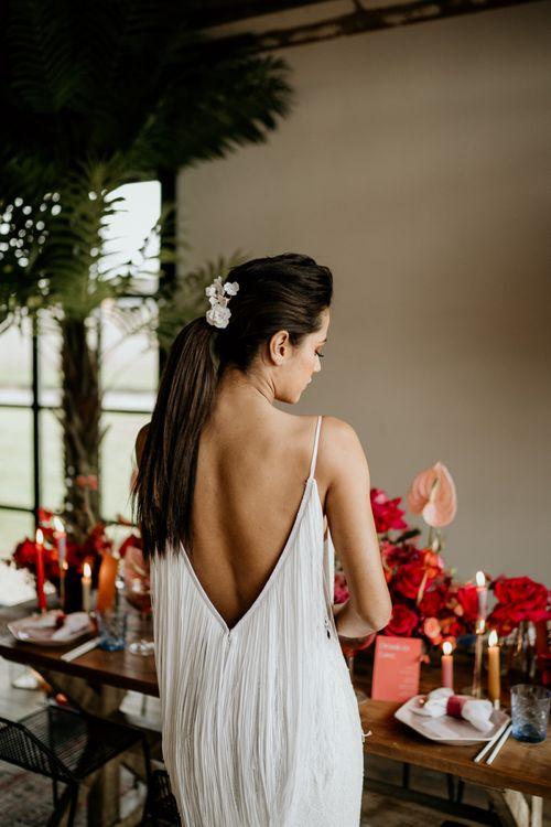 Bride in Low Fringe Back Wedding Dress with Sleek Pony Tail