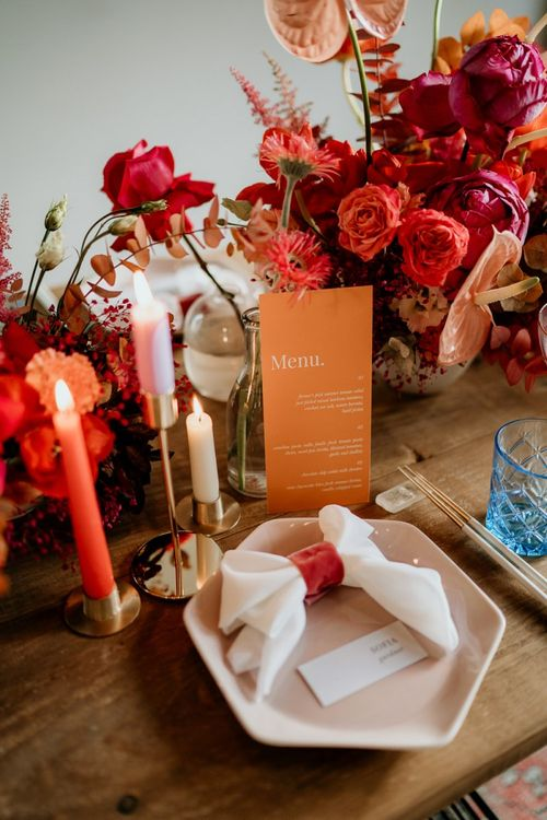 Place Setting with Red and Pink Wedding Flowers and Details