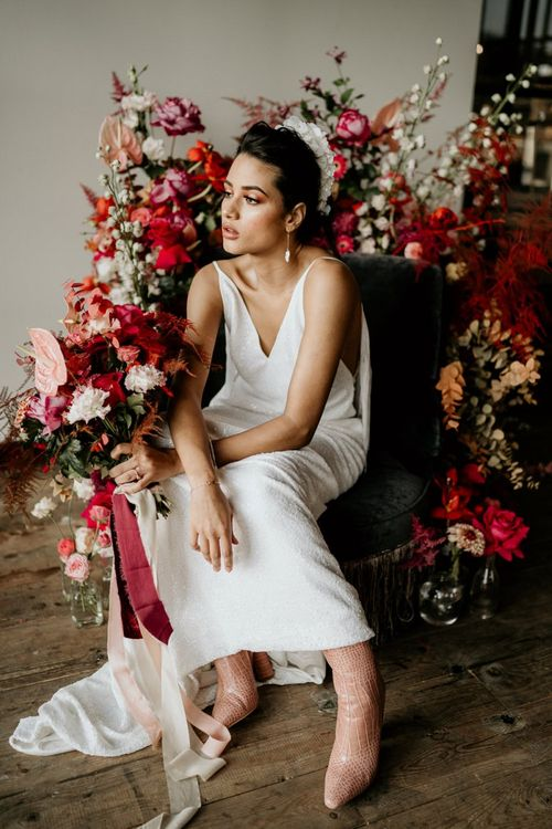 Bride in Minimalist Wedding Dress with Pink Bridal Boots Holding a Red & Pink Wedding Bouquet