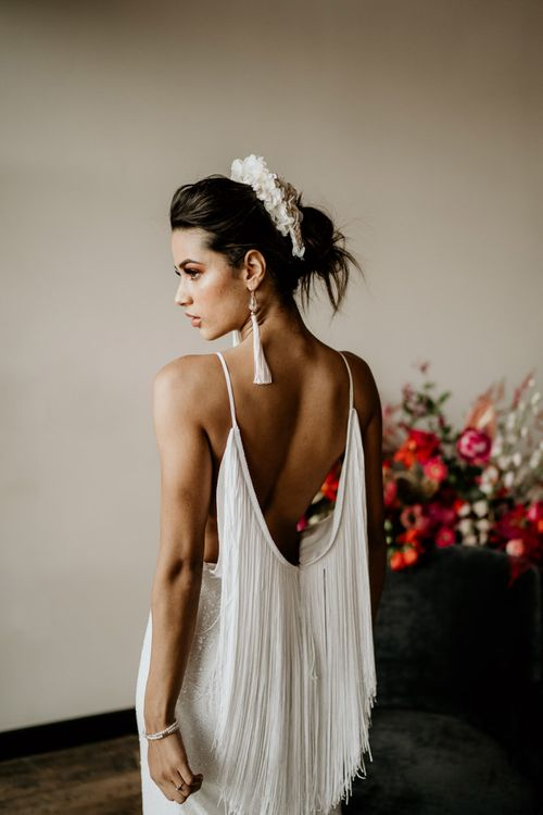 Modern Bride in a Minimalist Wedding Dress with Fringe Back Detail