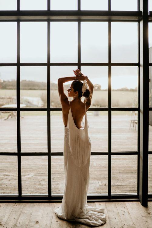 Modern Wedding Dress with Low Fringe Back Detail
