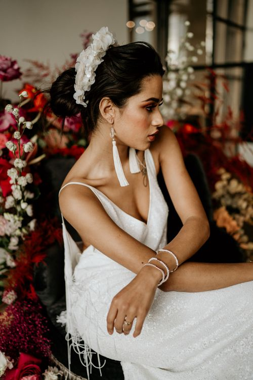 Stylish Bride with White Tassel Earrings and Applique Headdress and Bracelets