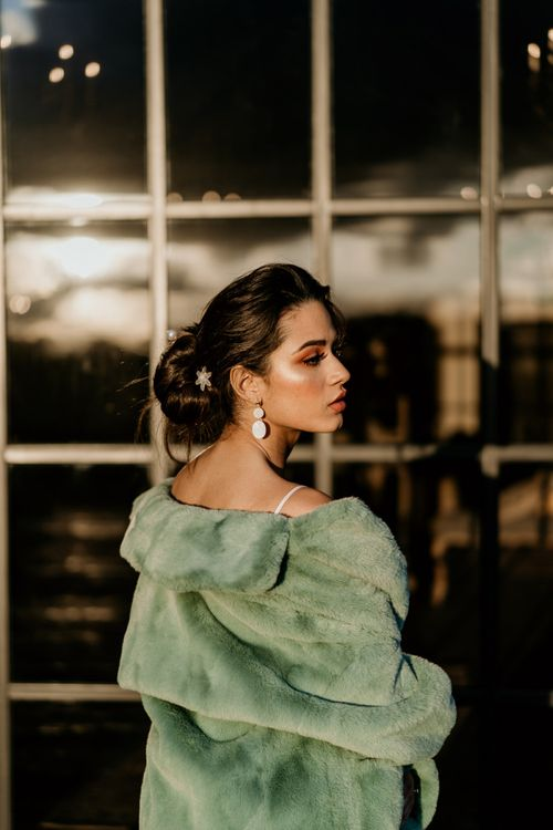 Bride with Messy Bun Updo, Disc Earrings and Blue Teddy Coat
