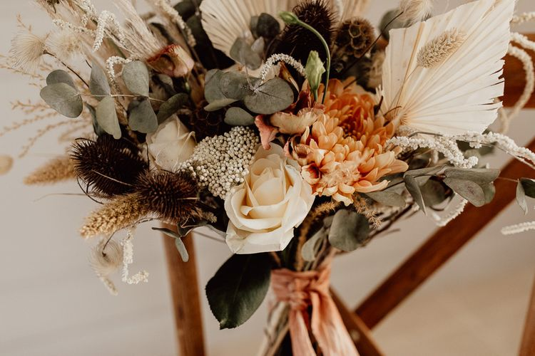 Natural Wedding Bouquet with Dried Flowers and Grasses, Foliage and Cream and Orange Flowers
