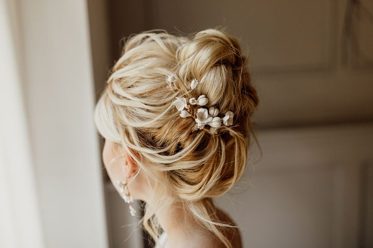 Messy Bun Wedding Hair Style with Hair Accessories