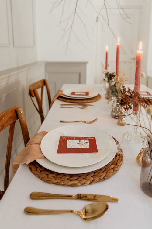Place Setting with Wicker Place Mat, Gold Cutlery and Menu Card