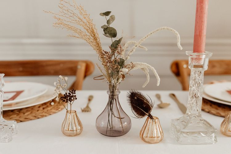 Small Votives with Flower Stems and Dried Grasses