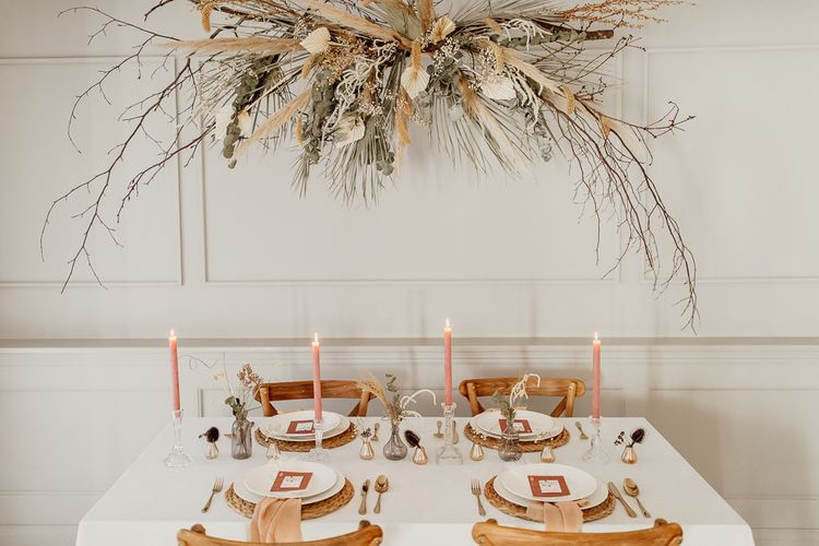 Tablescape Using Natural Wicker Place Mats and Linen, Taper Candles and Small Vessels for Dried Flower Centrepieces