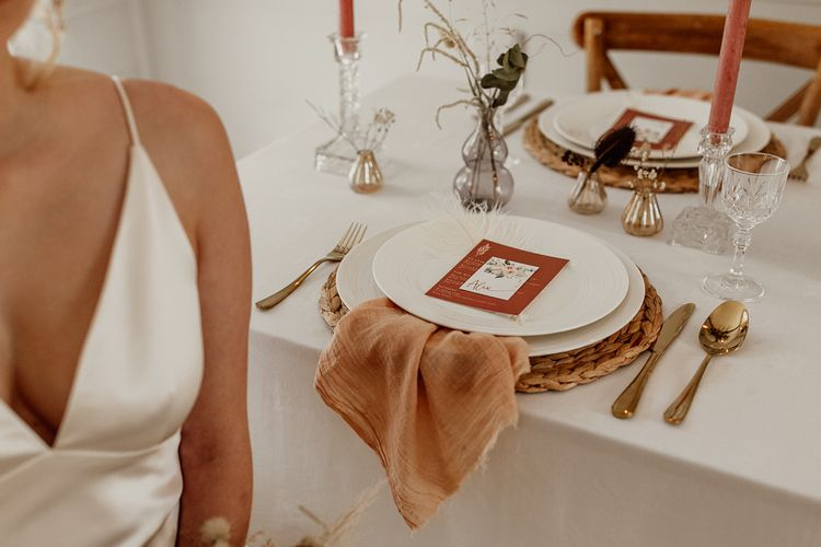 Place Setting with Natural Linen Napkin and Wicker Place Mat