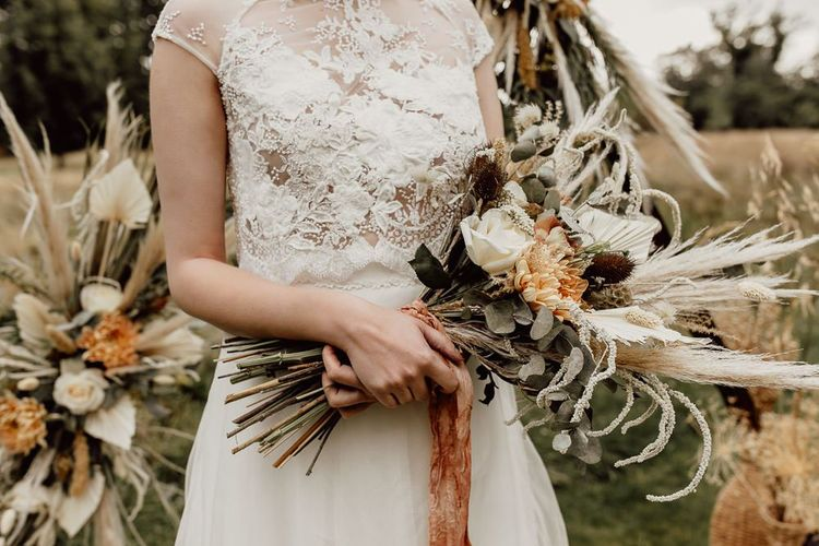 Boho Bride Holding a Bouquet of Dried Flowers and Grasses, Eucalyptus and Orange Flowers
