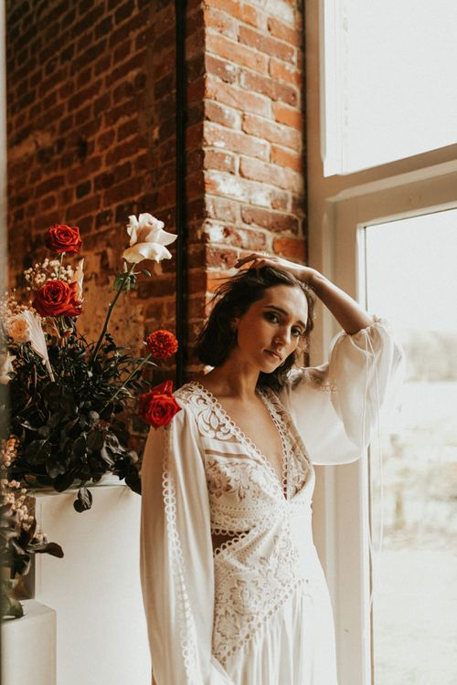 Boho wedding dress with lace detail and long bell sleeves