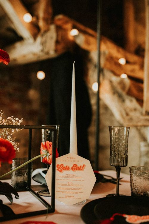 White taper candles and retro menu card