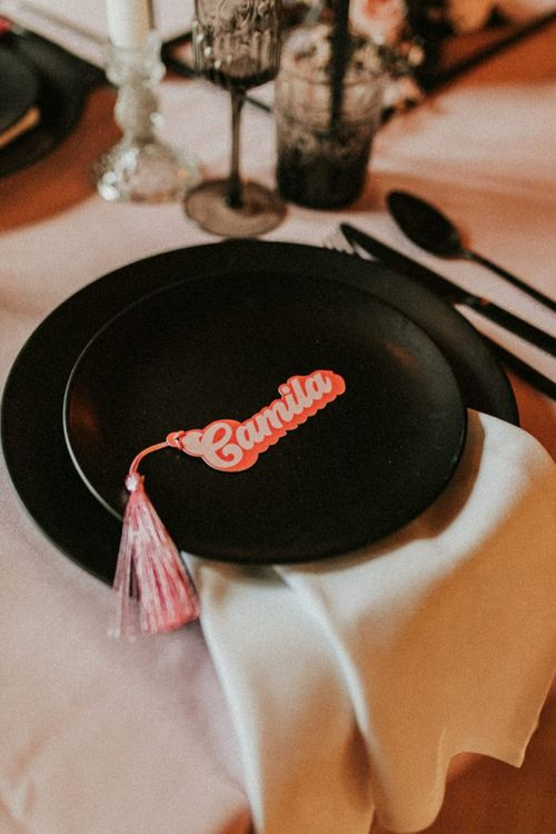 Black tableware and retro name place card with tassel