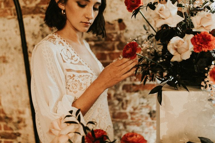 Boho bride in lace wedding dress at Godwick Great Barn