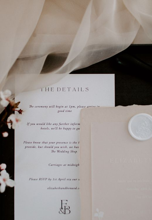 White wax seal on contemporary wedding stationery