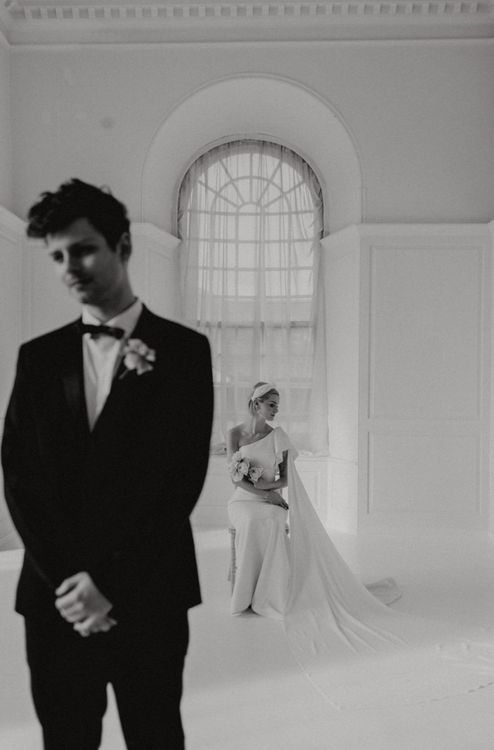 Bride in one shoulder modern wedding dress