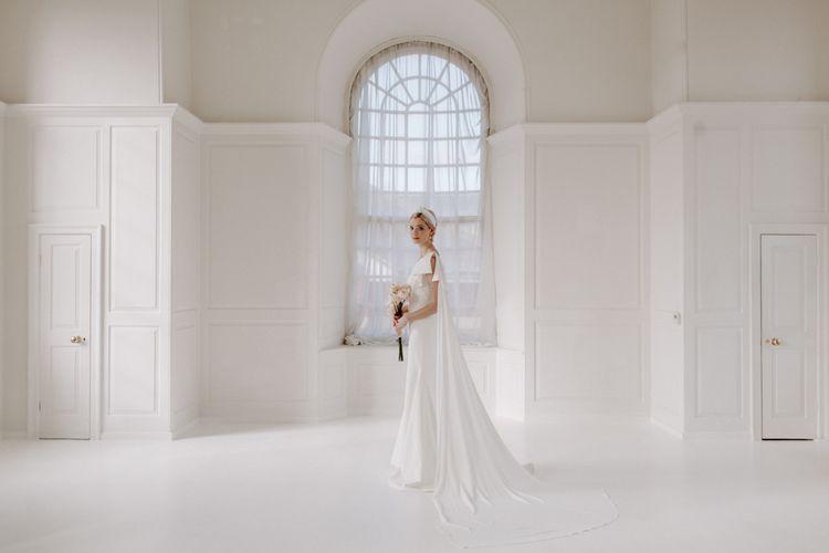 Modern bride in minimalist wedding dress