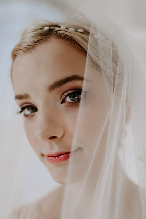 Wedding veil wrapped around the brides face