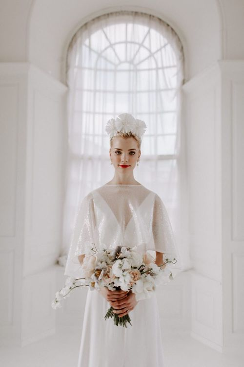 modern bride with sparkly wedding cape and bridal crown