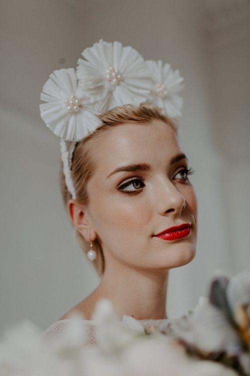 Modern bride wearing a white flower bridal crown