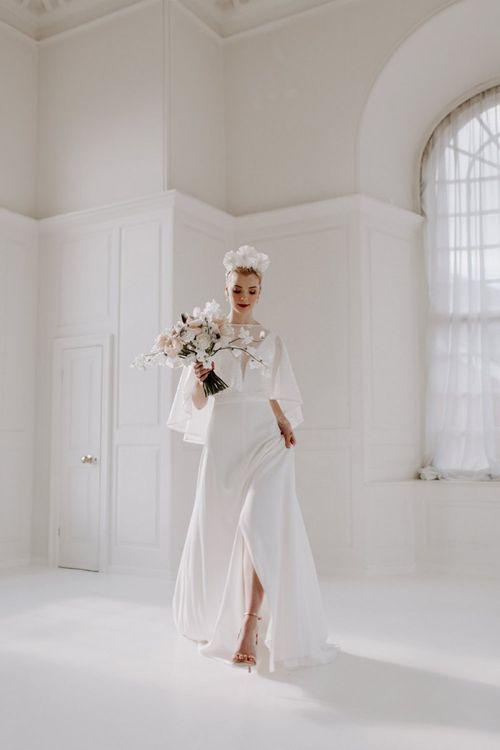 Modern bride wearing a front split wedding dress