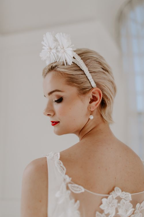 modern wedding ideas with bride with short hair showing off drop earrings